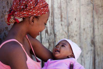 African mother with baby girl, location Mmankgodi village , Botswana
